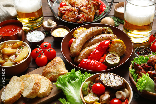 Delicious meal served for barbecue party on wooden table