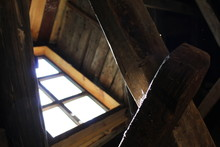Bright Light From The Window Falls On Beams And Cobwebs In An Old Wooden House.