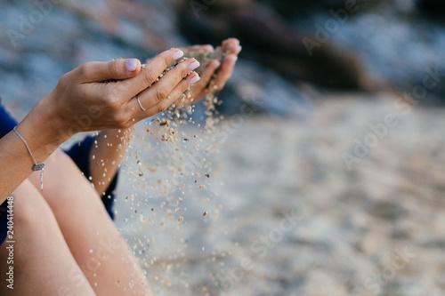 Fototapeta Detail of sand running through open hands. obraz