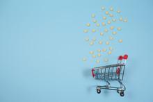 Empty Shopping Cart On Blue Background