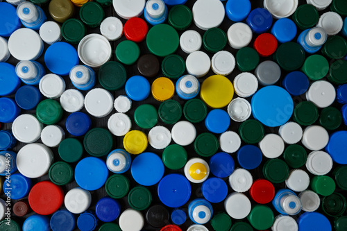 Collection of various colorful plastic screw caps #240419459