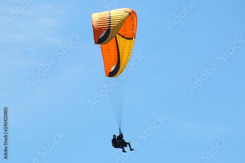 Tandem paraglider flying
