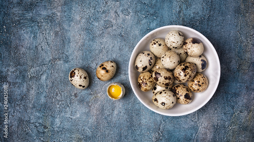 Top view on small quail eggs in white bowl