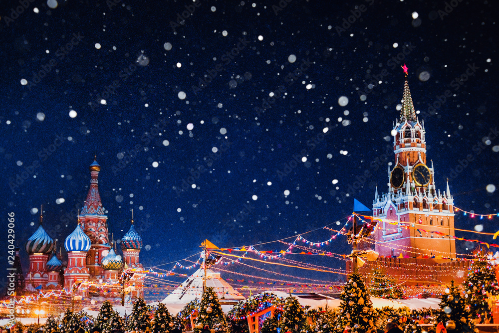 Fototapety, obrazy: Saint Basil cathedral and Spasskaya Tower among new year festive decorations on Red Square in Moscow. Christmas fair in Kremlin of Russia at evening while snow falling.