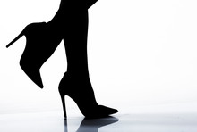 Silhouette Of Woman Heels. Legs