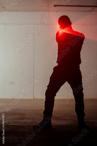 Photo  Silhouette of a man with laser gun
