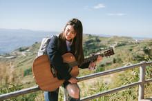 Beautiful Young Woman Playing ...