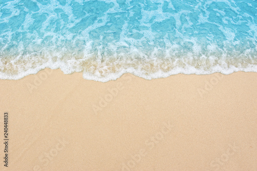 Fototapeta beautiful sandy beach and soft blue ocean wave obraz