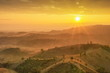 Mountain view misty morning, view of the hill and mountain around with soft mist with colorful yellow sun light in the sky background, sunrise at Doi Mae Salong, Chiang Rai, northern of Thailand.