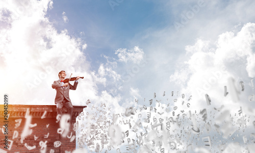 Stampa su Tela  Handsome businessman play his melody and symbols fly around in air