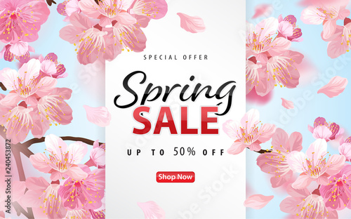 Foto Enjoy spring sale with blooming beautiful cherry blossoms or sakura flowers background template