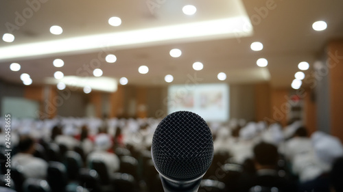 Fényképezés  Microphone over the Abstract blurred photo of conference hall or seminar room wi