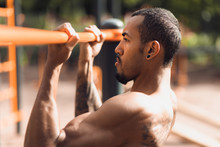 Crossfit Man Working Out Pull-...