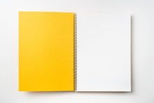 Top View Of Yellow Spiral Notebook With Open Page