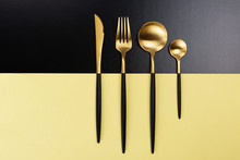 Set Of Black And Gold Cutlery