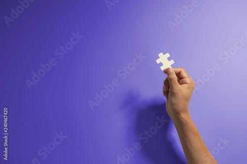 Fotografie, Obraz  Hand holding jigsaw piece