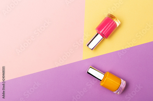 Nail polishes on colorful background