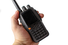 Male Hand Holding A Walkie Talkie On A White Background. Isolate
