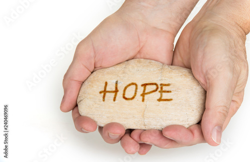 Fotografía  Pebble stone in hands. Concept for a  hope sign