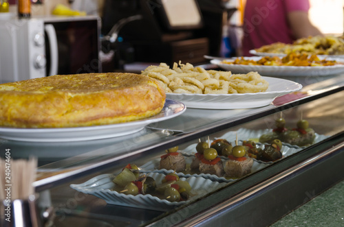 Spanish omelette, breaded squids, tuna tyipical spanish tapas