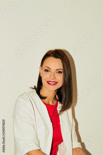 Fotografie, Obraz  Portrait of an attractive female doctor in white coat.
