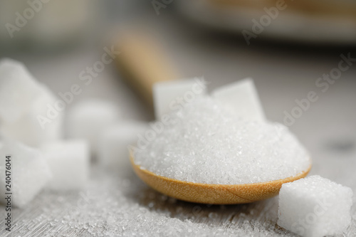 Fotografie, Obraz  Sugar in wooden spoon for putting in coffee, adding sweetness - image