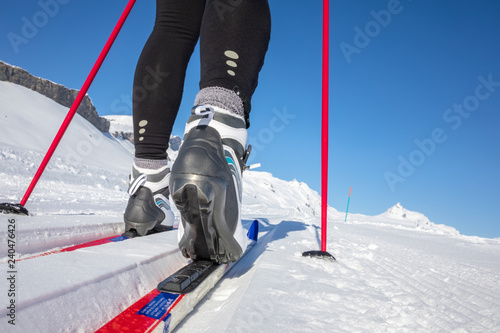 fototapeta na lodówkę Cross-country skiing: young woman cross-country skiing on a winter day (motion blurred image)