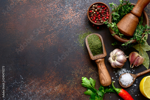 Photo  Culinary background with selection of spices, herbs and greens