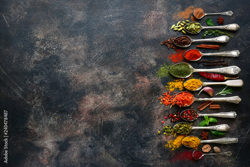 Assortment of natural spices on a vintage spoons Canvas Print