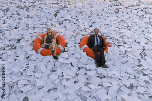 Cuadros en Lienzo two people are floating on the sea of paper