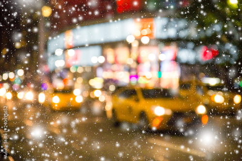Poster New York TAXI Defocused blur New York City Manhattan street scene with yellow taxi cabs and snowflakes falling during winter snow storm