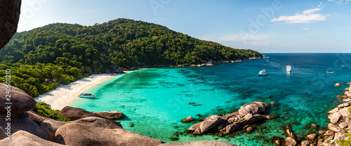 Panorama of a beautiful tropical sandy beach and lush green foliage on a tropical island (Koh Similan)