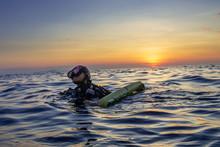 Female SCUBA Diver On The Surf...