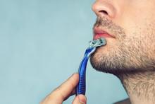 A Man Shaves A Shaving Machine...
