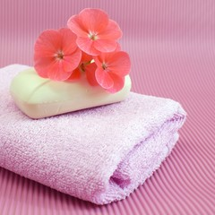 Obraz na płótnie Canvas Fragrant flower soap on a pink towel.