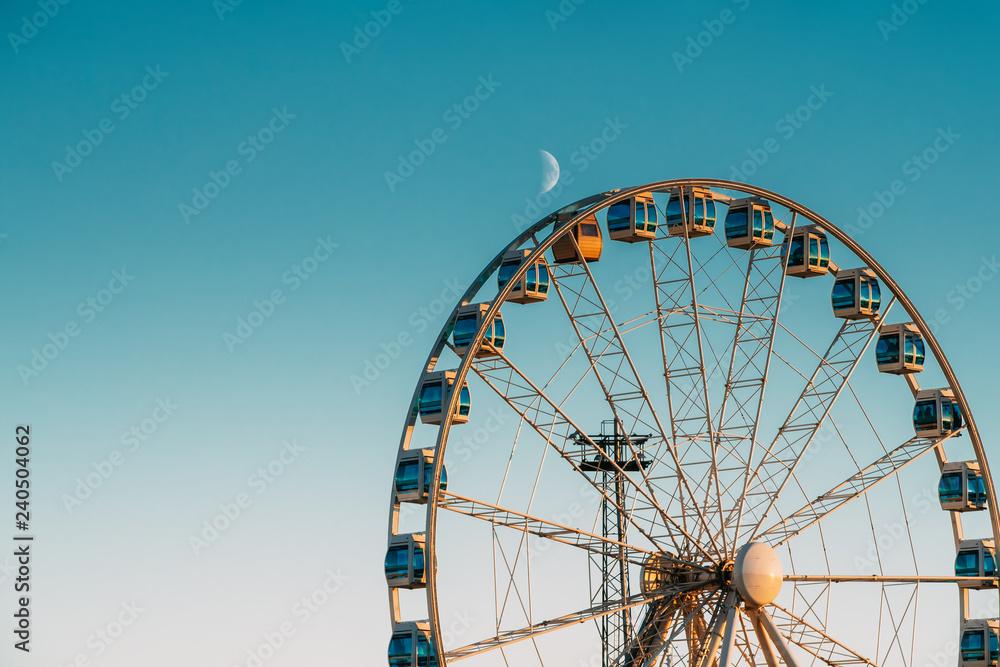 Fototapeta Helsinki, Finland. Moon Rising Above Ferris Wheel
