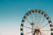 Helsinki, Finland. Moon Rising Above Ferris Wheel