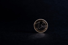 Shiny One Euro Coin On Black Background