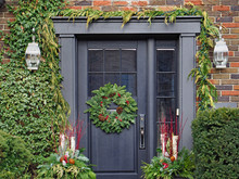 Front Door With Holiday Decora...