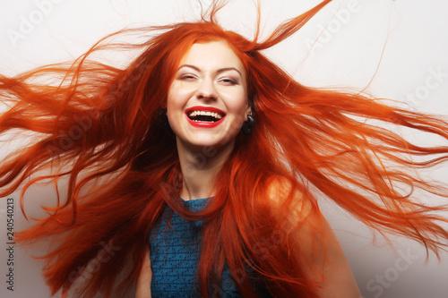 woman with long flowing red hair Fototapeta