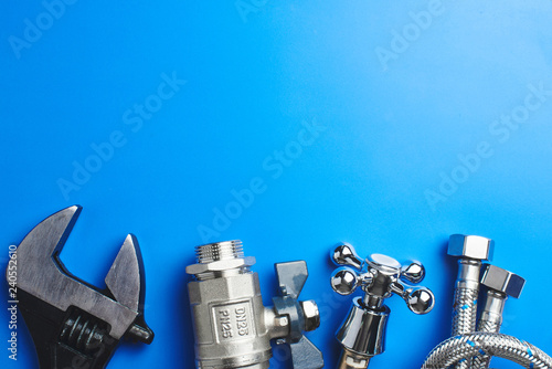 Fotografía  plumbing tools and equipment on blue background with copy space