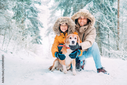 75f0cd939bcd5 Father and son dressed in Warm Hooded Casual Parka Jacket Outerwear walking  with their beagle dog