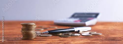 Fototapeta pennies and calculator obraz