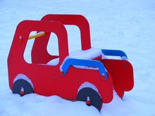 Children's Red Car In The Snow...
