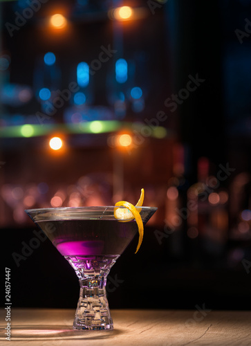 Violet sweet cocktail in a bar