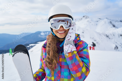 Fotografía Happy Young Woman Skier Enjoying Sunny Weather In Alps Stock Photo