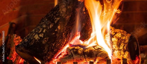 Cozy fireplace. Wood logs burning, relaxation and warm home