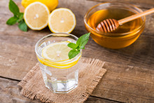 Honey And Lemon Drink. Detox Water With Honey, Lemon And Mint, Health And Organic.
