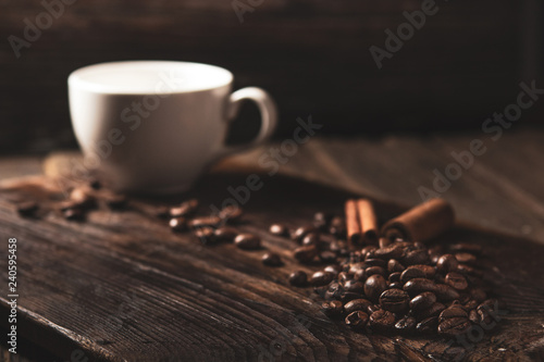 Photo Stands Coffee beans coffee beans and white mug on wooden dark background. Rustic style