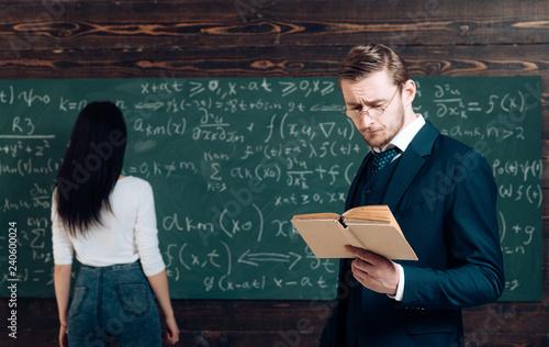 Photo  Working a problem in algebra